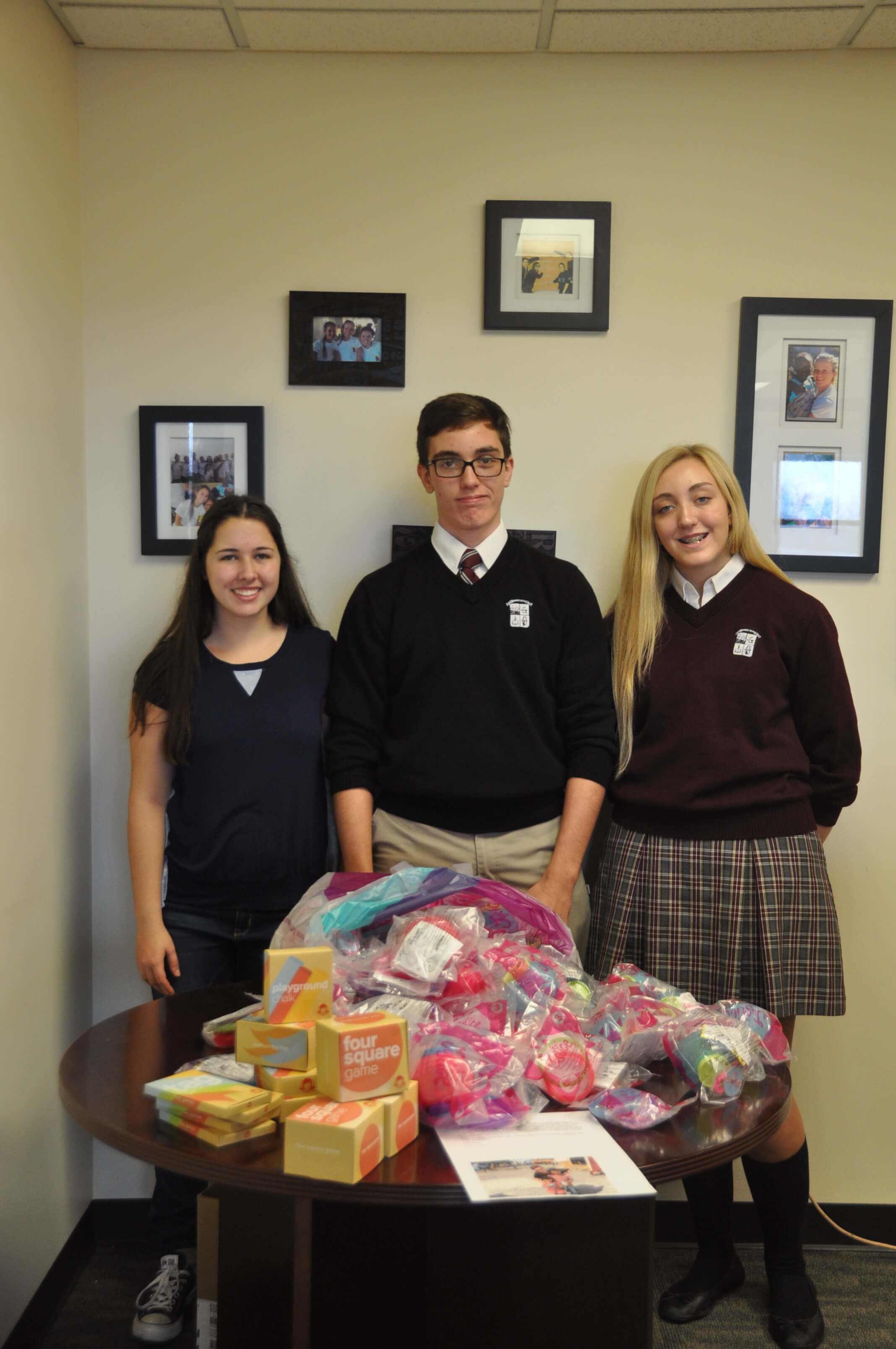Kathryn Steel, Jeffrey and Madeline Thewes with some of their toy donations for children in Guatemala