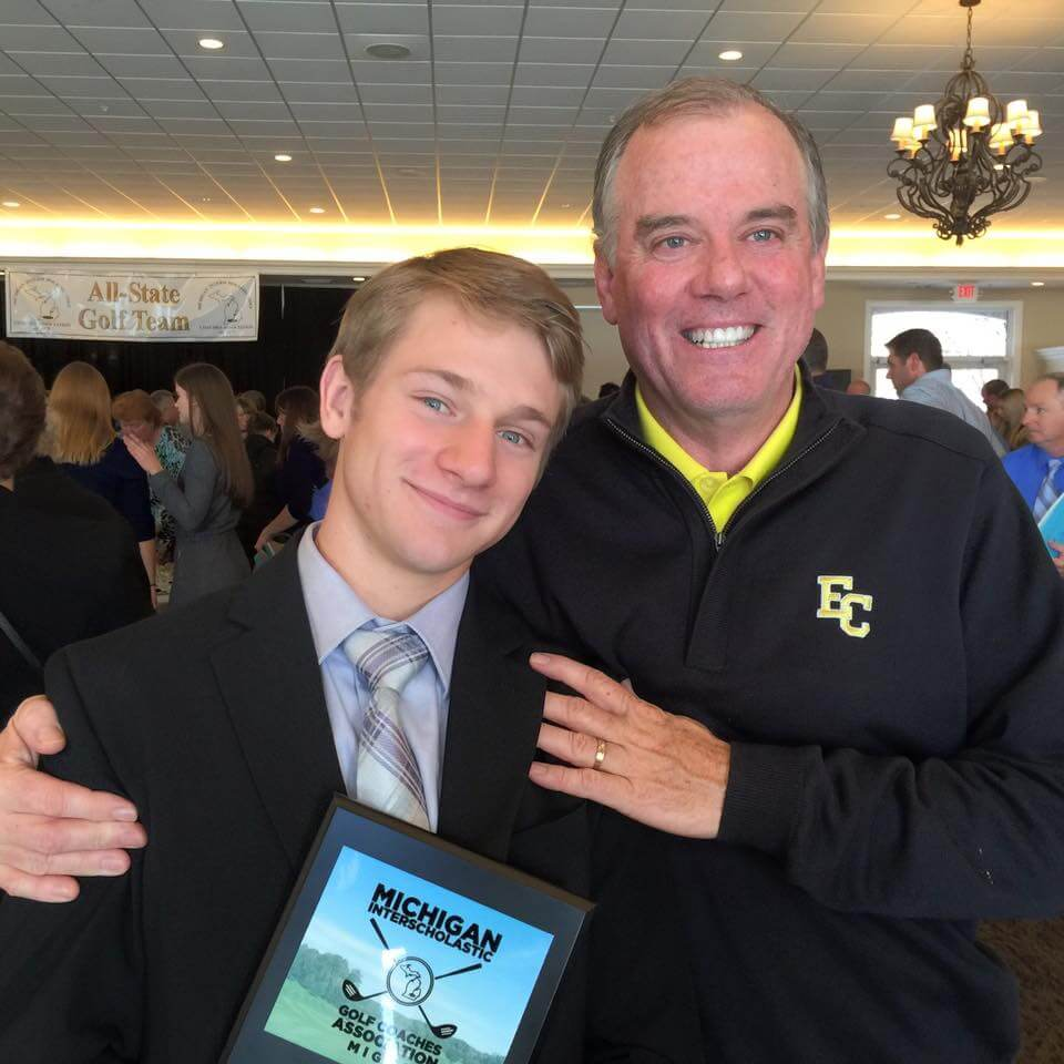 Tyler Rozwadowski with EC Head Golf Coach Dave Smith