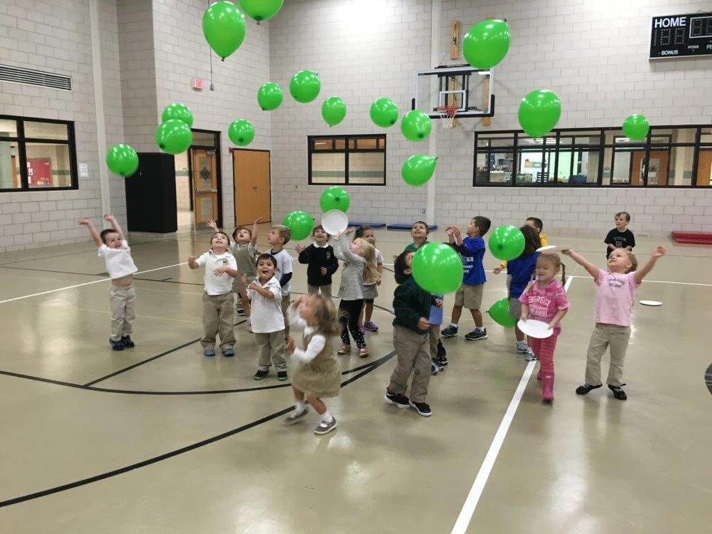 Preschool students enjoy a little time at play with some balloons!