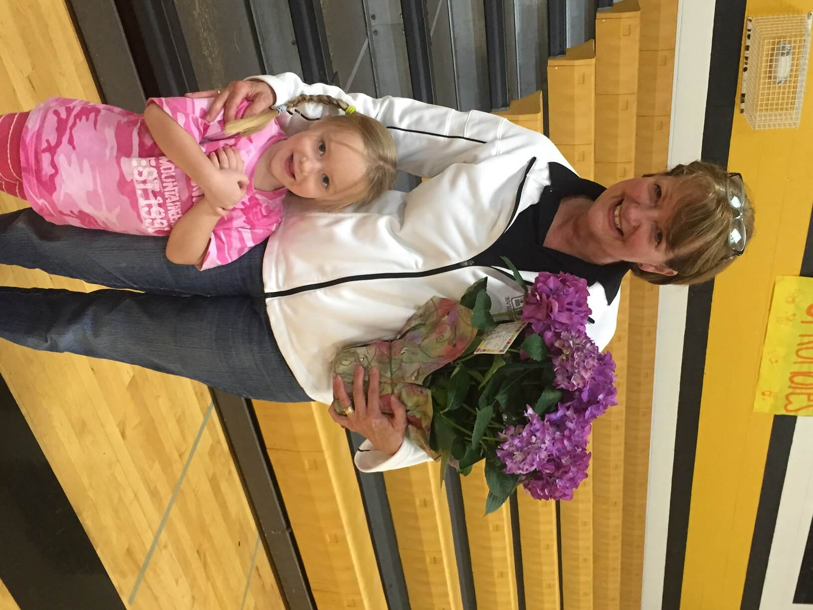 Katie Shea presents Mrs. Martin with flowers