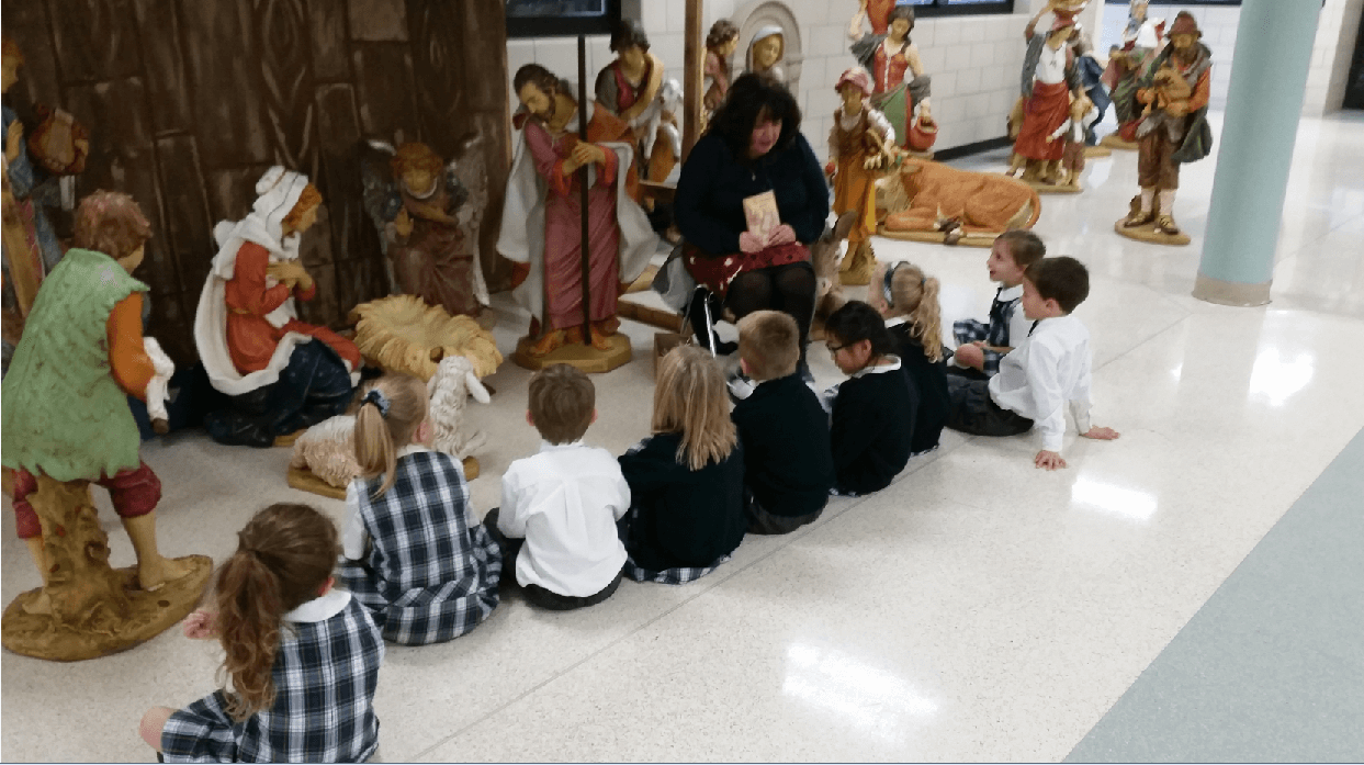 Mrs. Radich gives the Everest Junior Kindergarten a lesson about Advent.