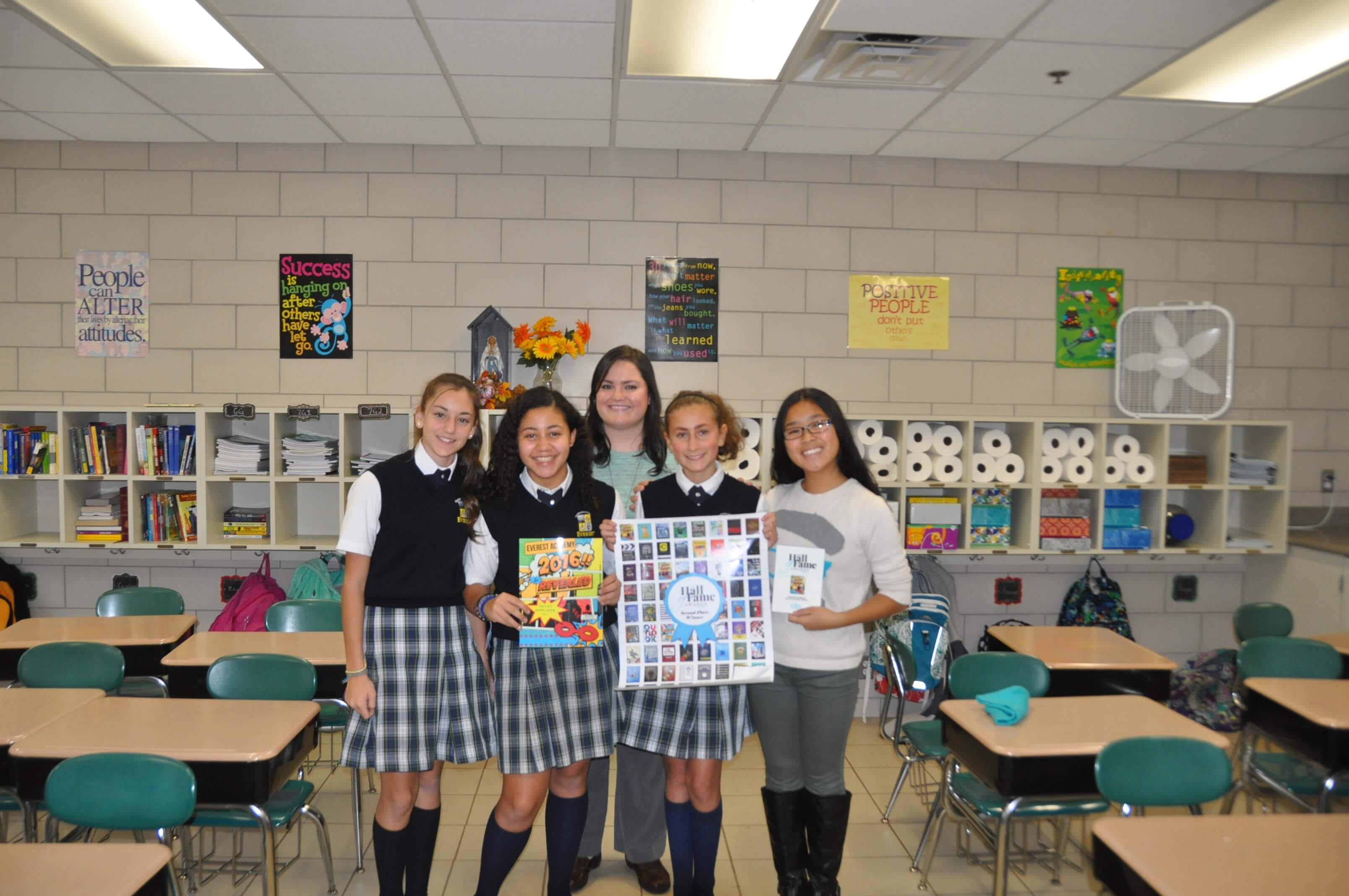 Mrs. DiFonzo (left) with yearbook staff members  Angela Tibudan, Molly Burgess, Andrea Gonzalvo and Lucia Dominguez, accepting the award.