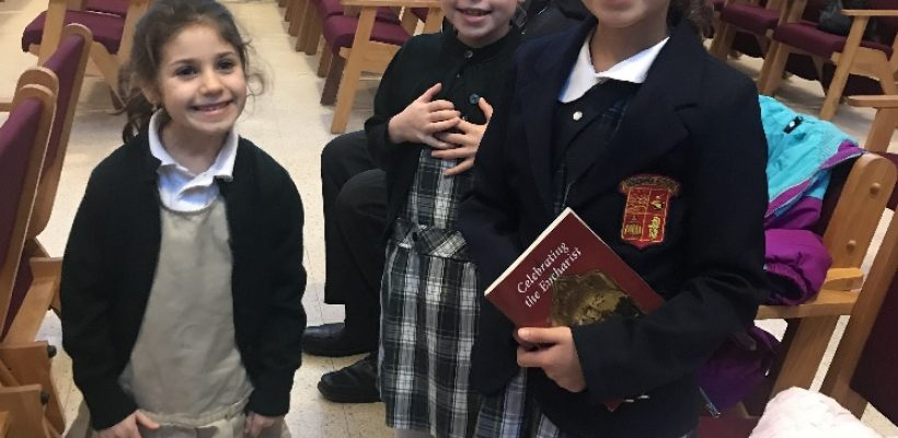 Students Wear Uniforms to Promote Jan. 28 Open House at Parish Masses