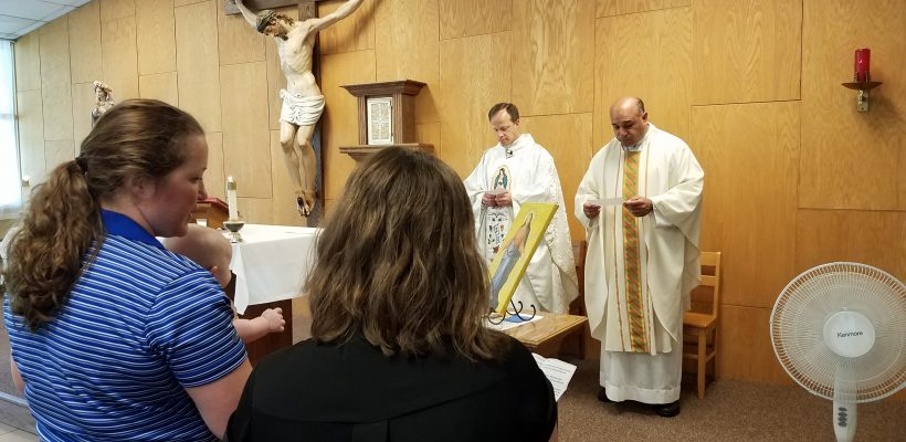 Everest faculty and staff participate in consecration of Everest to Mary