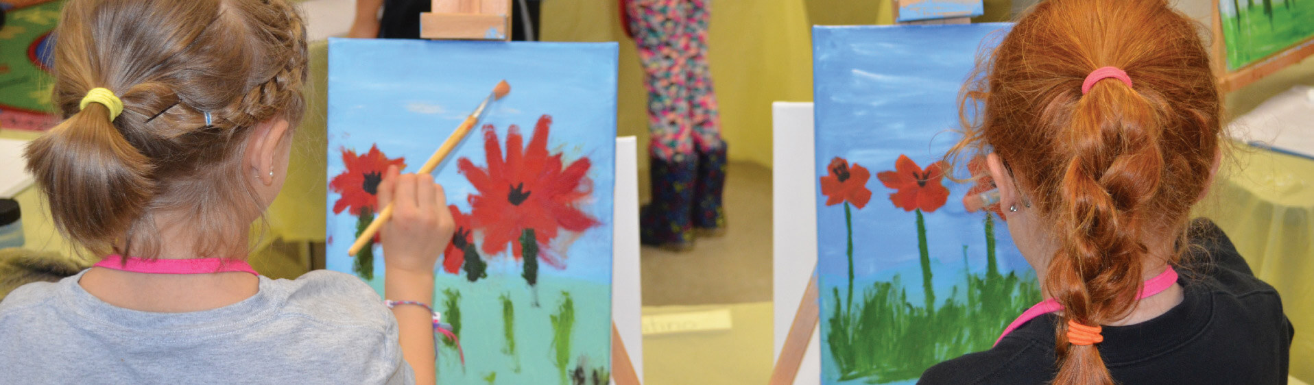Early years students painting