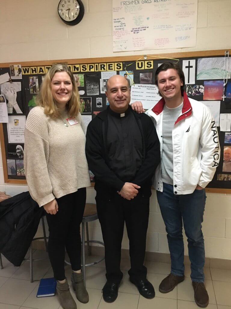 Parent and student with Father Thomas