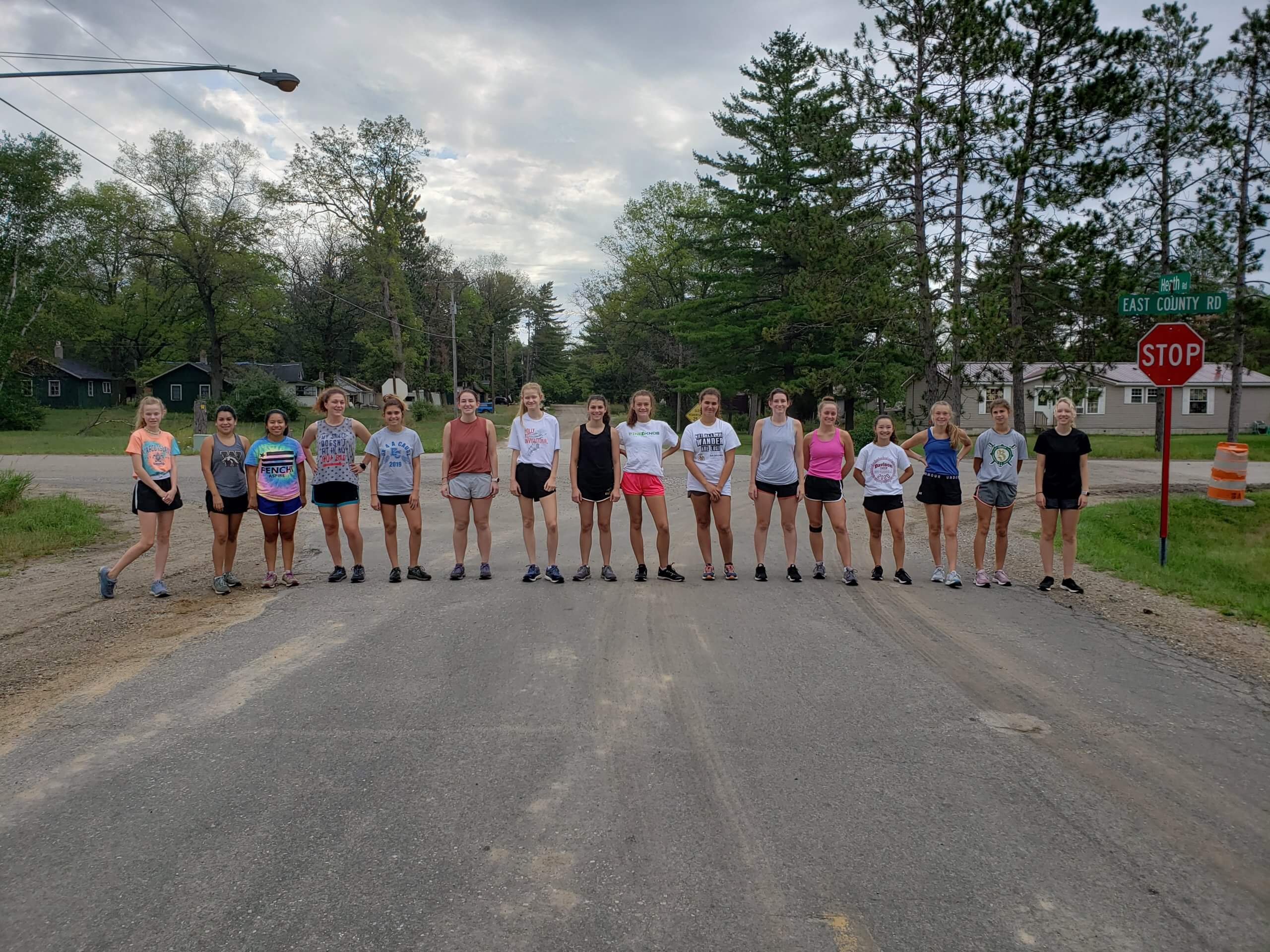 Cross country runners at road